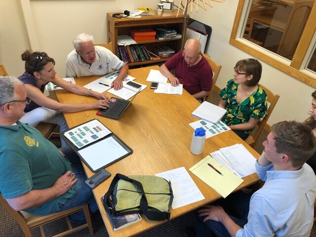 Intern Jessica Biggott is on the right in a planning meeting with the Harmful Algal Blooms monitoring team.