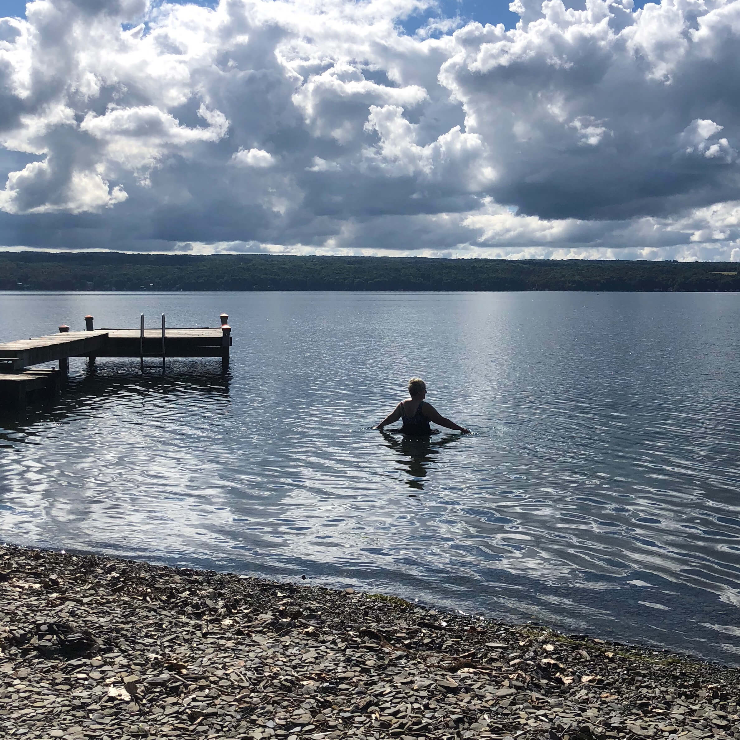 Woman swimming in Cayuga Lake
