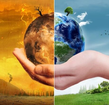 Depiction of climate extremes. Hand holding globe one half of which is hot, one cold.